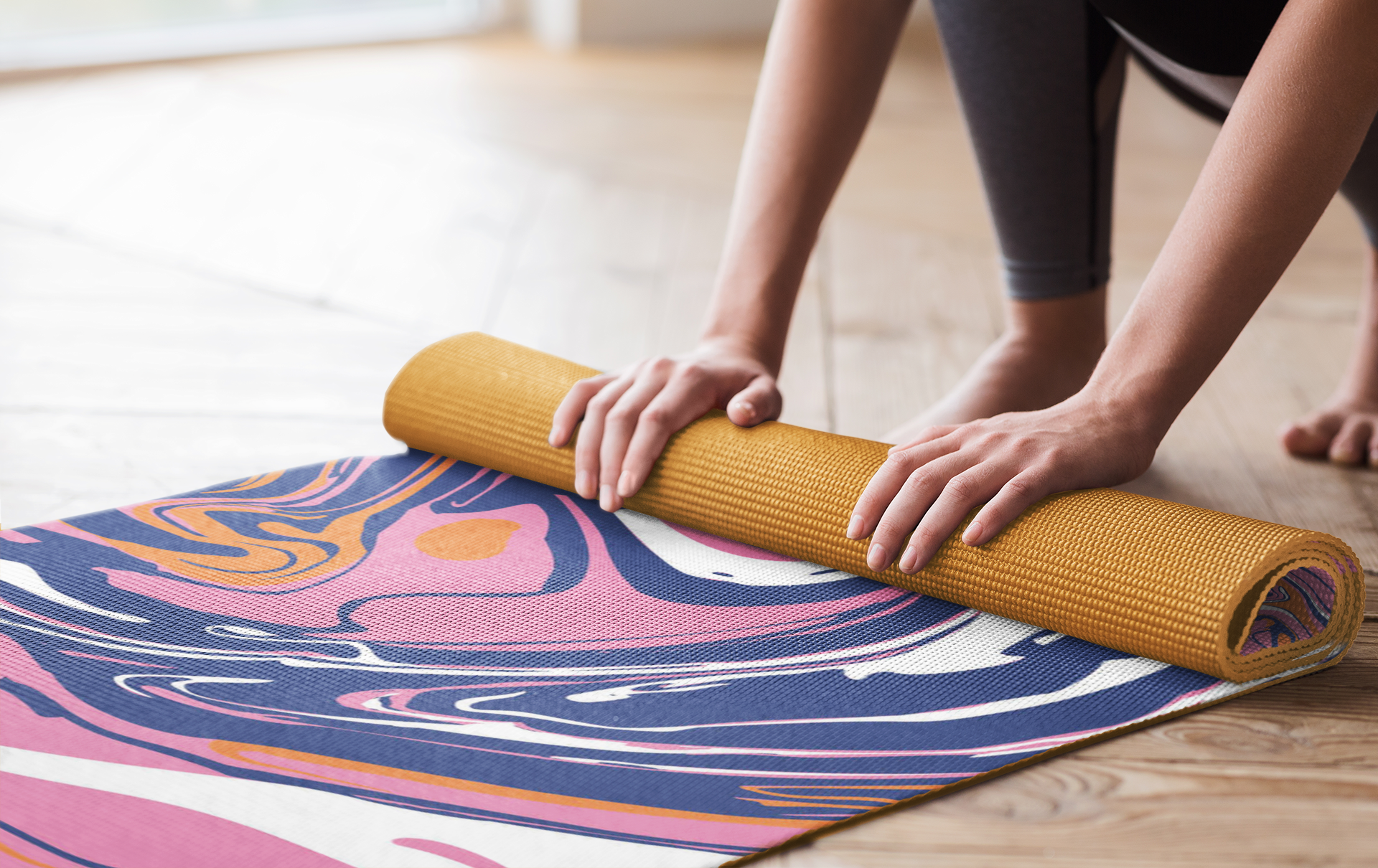 mockup-of-a-woman-rolling-up-her-sublimated-yoga-mat-37074-r-el2
